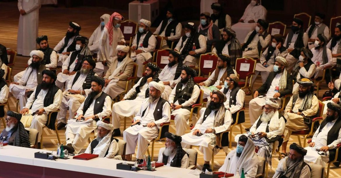 Members of the Taliban delegation attend the opening session of peace talks with the Afghan government in Doha.
