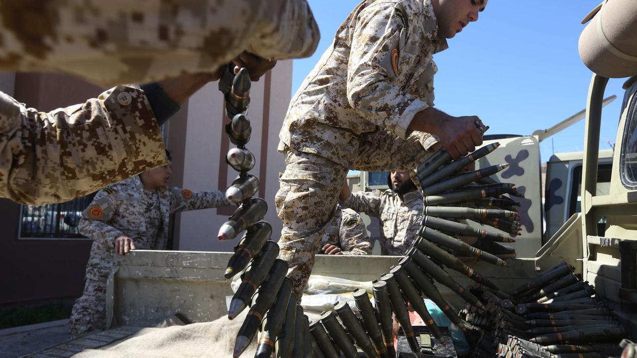 Fighters loyal to the Libyan Government of National Accord (GNA) prepare their ammunition.