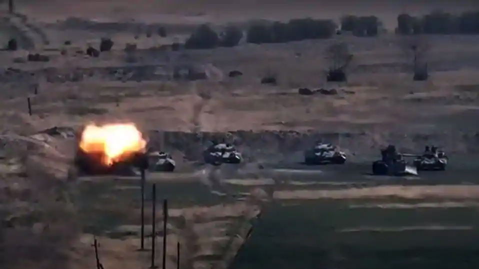 An image grab taken from a video made available on the official web site of the Armenian Defence Ministry on September 27, 2020, allegedly shows destroying of Azeri military vehicles during clashes between Armenian separatists and Azerbaijan in the breakaway region of Nagorno-Karabakh