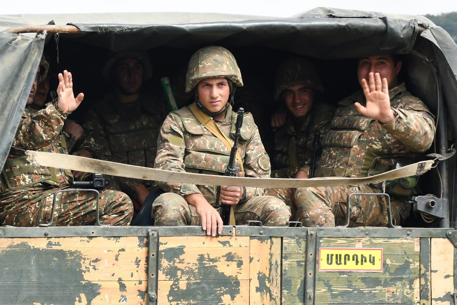 Armenian soldiers on the back of a truck