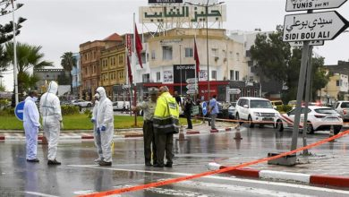 Attackers with knives killed a Tunisian National Guard officer and wounded another before three assailants were shot dead