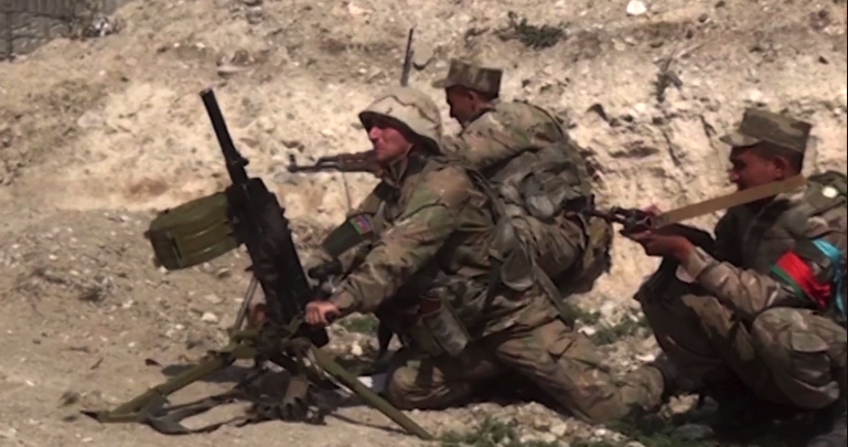 An image grab taken from a video made available on the official web site of the Azerbaijani Defence Ministry on 28 September 28, 2020, allegedly shows Azeri troops conducting a combat operation during clashes between Armenian separatists and Azerbaijan in the breakaway region of Nagorno Karabakh