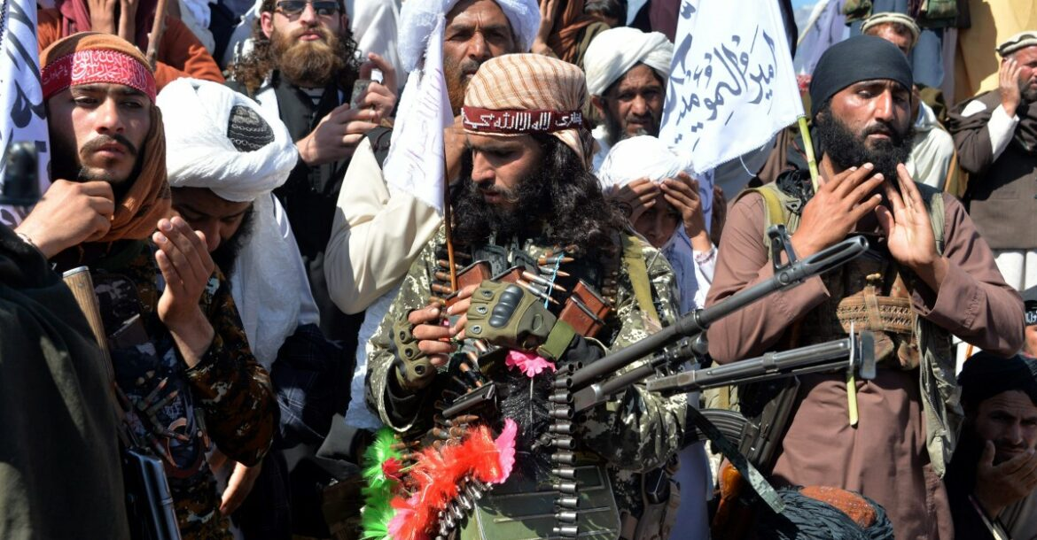 Photo of Taliban militants and villagers attend a gathering to celebrate the peace deal with the US in Afghanistan's Laghman province on March 2, 2020