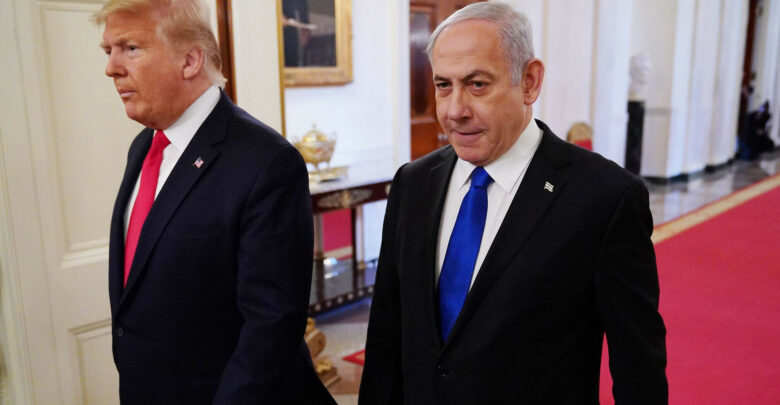 US President Donald Trump and Israel's Prime Minister Benjamin Netanyahu arrive for an announcement of Trump's Middle East peace plan at the White House, January 28, 2020.