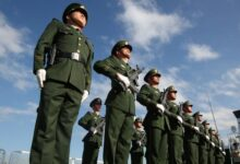 The Chinese coastguard stand in attention.