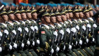 Chinese military troops march on.