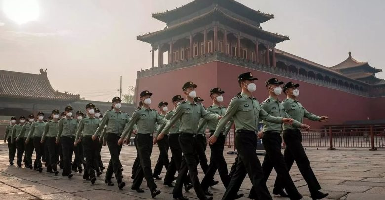 People's Liberation Army (PLA) soldiers march during the opening ceremony of the Chinese People's Political Consultative Conference (CPPCC) in Beijing