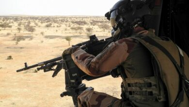 A French soldier aims his rifle at the target.