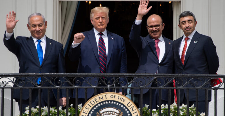 Israeli Prime Minister Benjamin Netanyahu, US President Donald Trump, Bahrain Foreign Minister Abdullatif al-Zayani, and UAE Foreign Minister Abdullah bin Zayed Al-Nahyan wave from the Truman Balcony at the White House after they participated in the signing of the Abraham Accords.