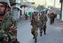 Photo of African Union troops from Tanzania and Comoran troops walking down a street in Anjouan on March 25, 2008