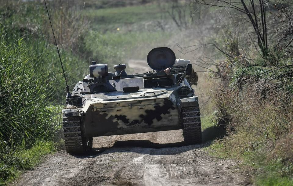 An Armenian armoured vehicle drives towards the front line on October 25, 2020, during the ongoing fighting between Armenian and Azerbaijani forces over the breakaway region of Nagorno Karabakh.