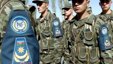 Members of the Azerbaijan Army pass in review during CENTRASBAT (Central Asian Peacekeeping Battalion) 2000 opening ceremonies on September 13th, 2000.