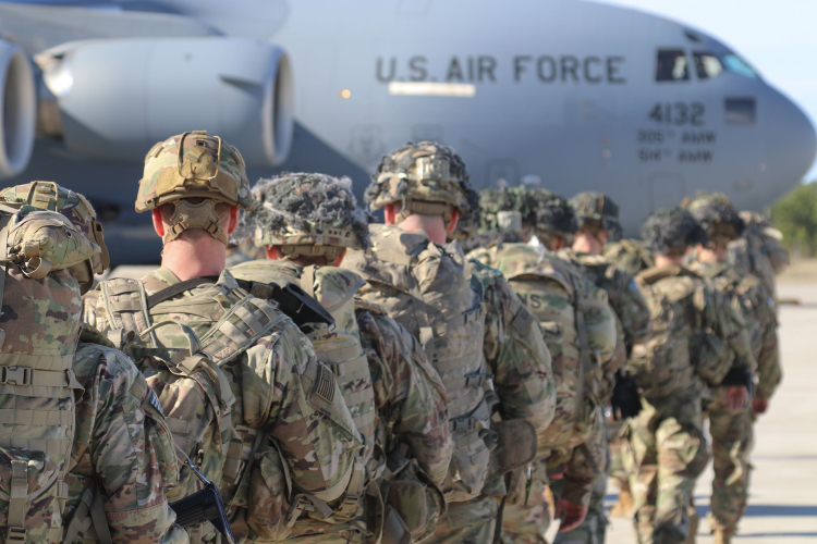 This handout picture released by the US Army shows U.S. Army Paratroopers assigned to the 2nd Battalion, 504th Parachute Infantry Regiment, 1st Brigade Combat Team, 82nd Airborne Division, deploy from Pope Army Airfield, North Carolina on January 1, 2020