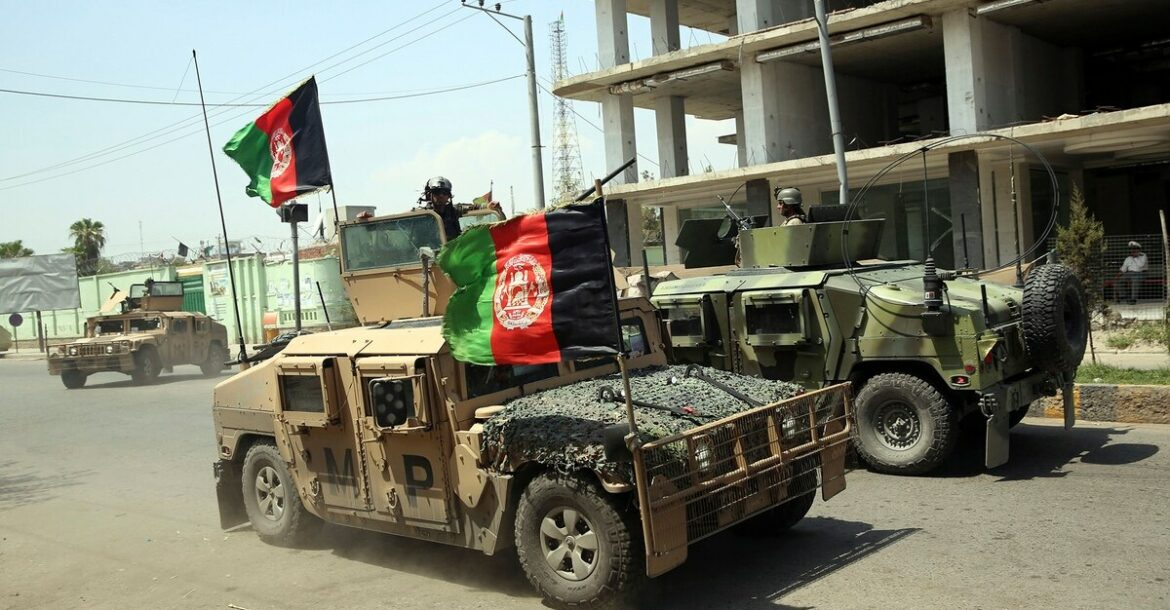 Afghan security personnel gather near a prison in Kabul.