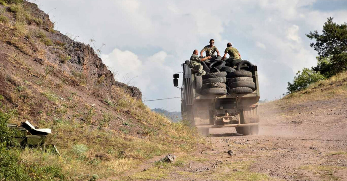 Armenian servicemen transport used tires in the back of a truck to fortify their positions on the Armenian-Azerbaijani border near the village of Movses on July 15, 2020
