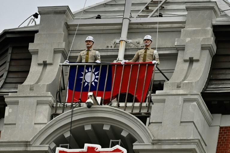 Taiwan's military police prepare to raise the flag during a ceremony to mark Taiwan National Day at the Presidential Office in Taipei on October 10, 2020 Sam Yeh