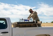 U.S. Air Force Master Sgt. Joshua Hicks, 60th Security Forces Squadron flight chief, secures an Easy Aerial drone inside of the ground charging station July 10, 2020, at Travis Air Force Base, California.