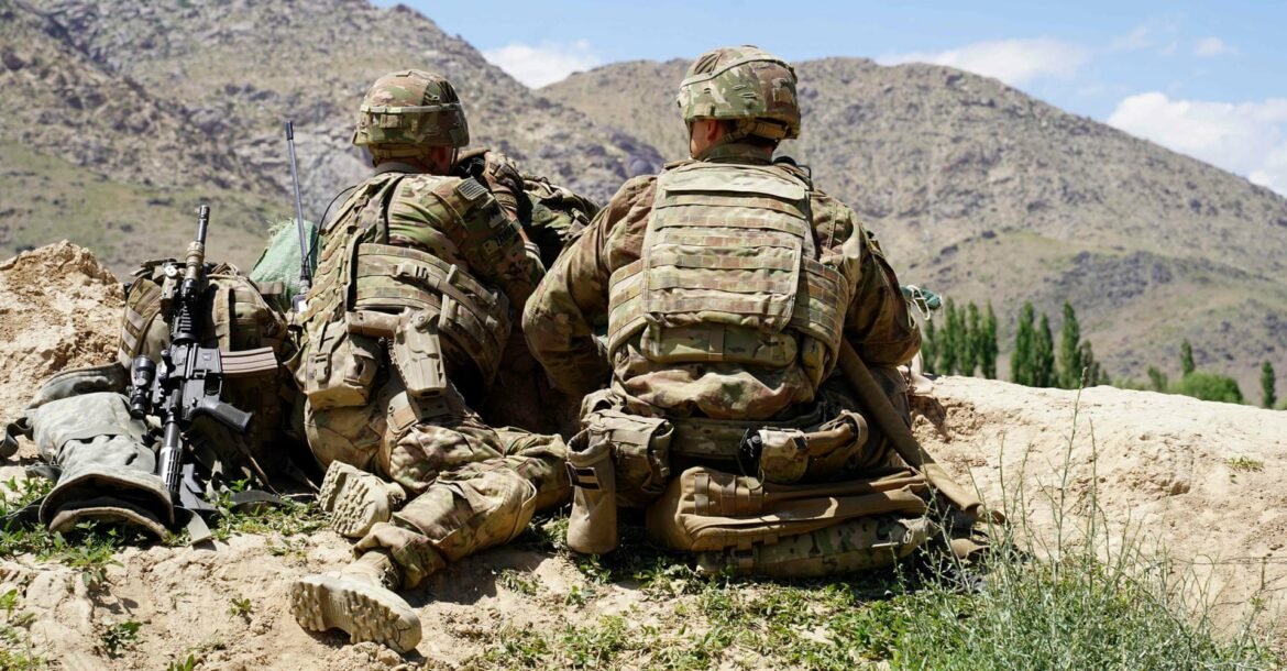 In this file photo taken on June 6, 2019 US soldiers look out over hillsides during a visit of the commander of US and NATO forces in Afghanistan General at the Afghan National Army (ANA) checkpoint in Nerkh district of Wardak province.