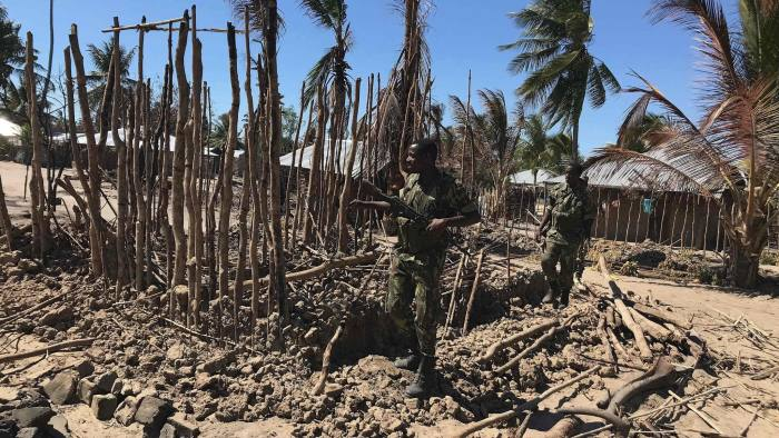 Mozambican soldiers inspect a building torched by insurgents in northern Mozambique.