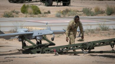 Photo of a Tactical Unmanned Aerial System maintainer with 3rd Squadron, 6th Cavalry Regiment, conducting final preflight checks during operational tests of the new RQ–7B Shadow Block III system at Fort Bliss, Texas