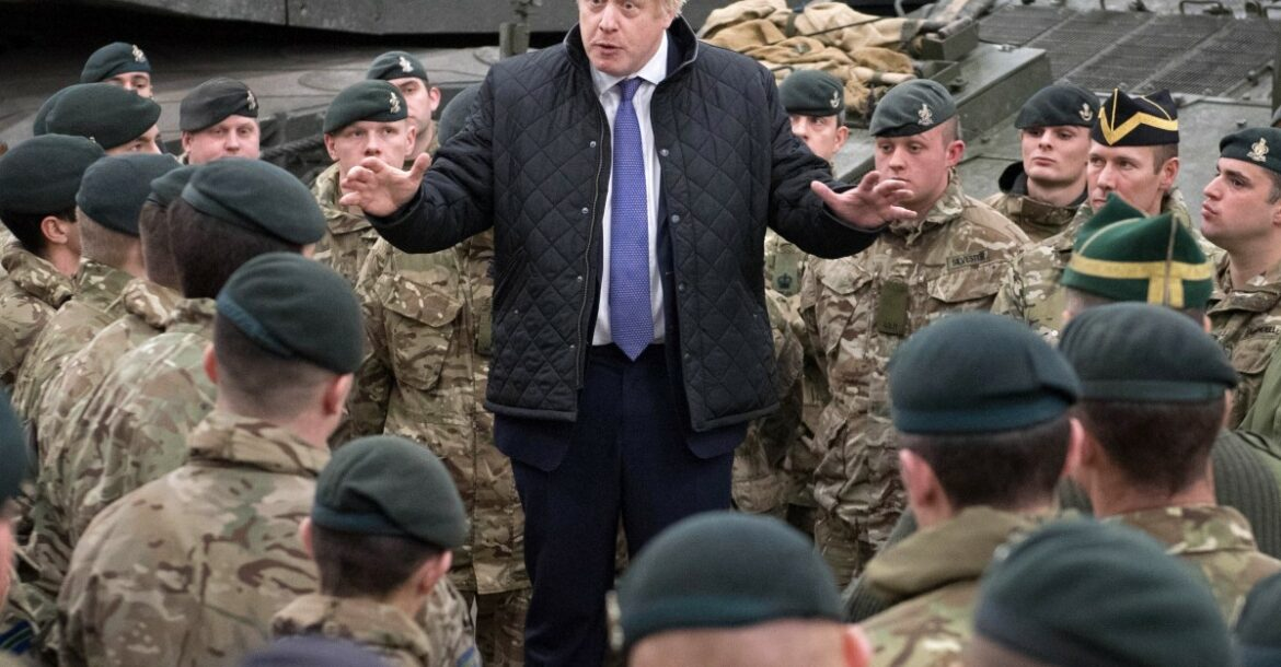 Britain's Prime Minister Boris Johnson speaks with troops.