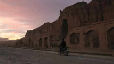 File: A man rides his motorbike during sunset in front of the empty seat of one of the two Buddha statues destroyed by the Taliban in 2001 in Bamiyan, on November 19, 2019