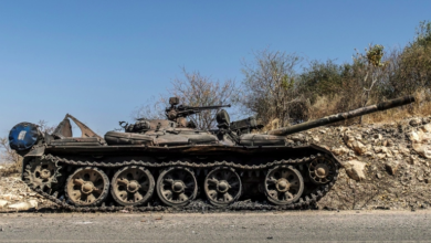 A damaged tank is abandoned on a road near Humera, Ethiopia, November 22, 2020