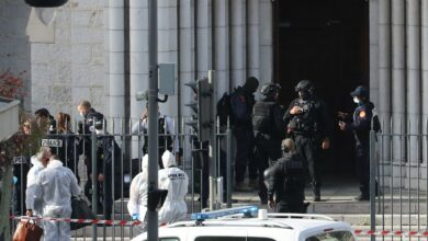 French members of the elite tactical police unit RAID enter to search the Basilica of Notre-Dame de Nice as forensics officers wait outside after a knife attack in Nice on October 29, 2020