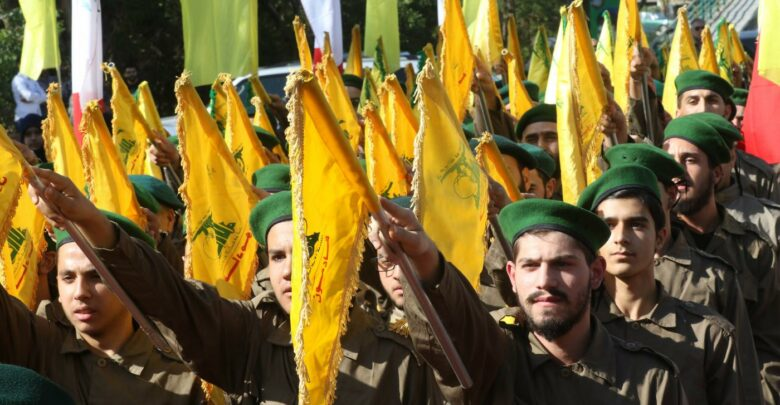 Hezbollah fighters take part in a military parade marking the group's Martyrs' Day in the southern town of Ghazieh, south of the port city of Sidon, 12 November 2019