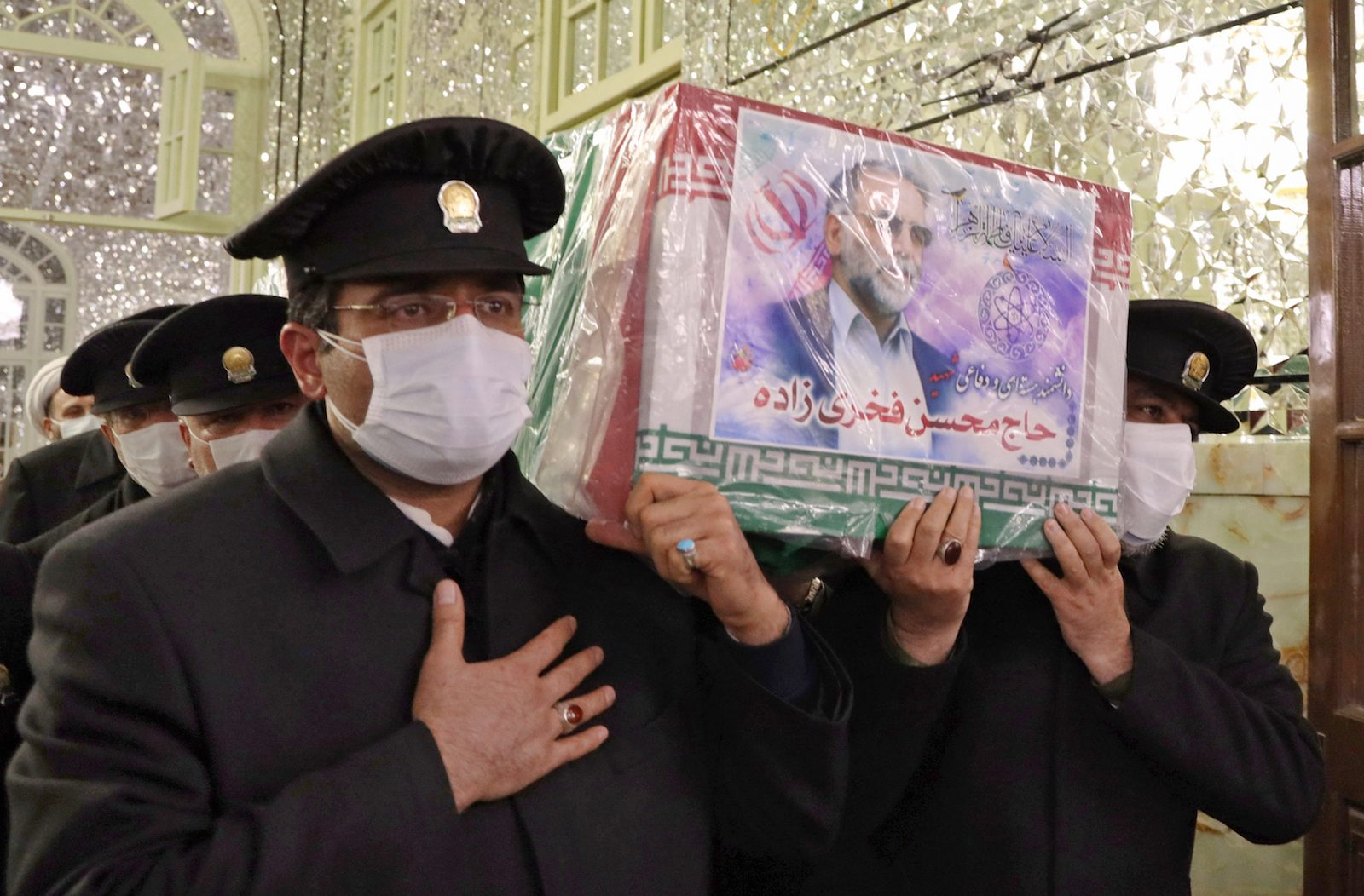 Servants carry the coffin of Iran's assassinated top nuclear scientist Mohsen Fakhrizadeh