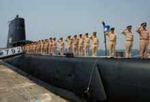 Taiwanese navy staff salute from a US-made Guppy class submarine at the Tsoying navy base in southern Kaohsiung on September 30, 2014.