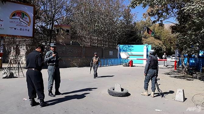 Policemen stand guard at an entrance gate of Kabul University in Kabul, Afghanistan, on November 2, 2020.