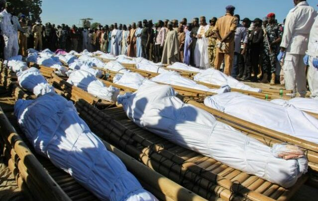 Mourners attend the funeral of 43 farm workers in Zabarmari, Nigeria on Nov 29, 2020 after they were killed by jihadists in rice fields near the village of Koshobe on November 28, 2020