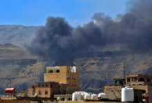 Smoke billows following a reported airstrike by the Saudi-led coalition in the Yemeni capital Sanaa, on November 27, 2020