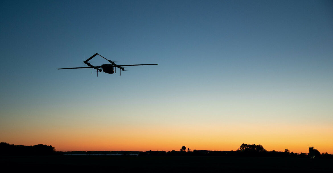 An autonomous vehicle dubbed Blue Water Maritime Logistics UAS flies over Unmanned Air Test and Evaluation (UX) 24 during a demonstration flight at Naval Air Station Patuxent River November 4, 2020.