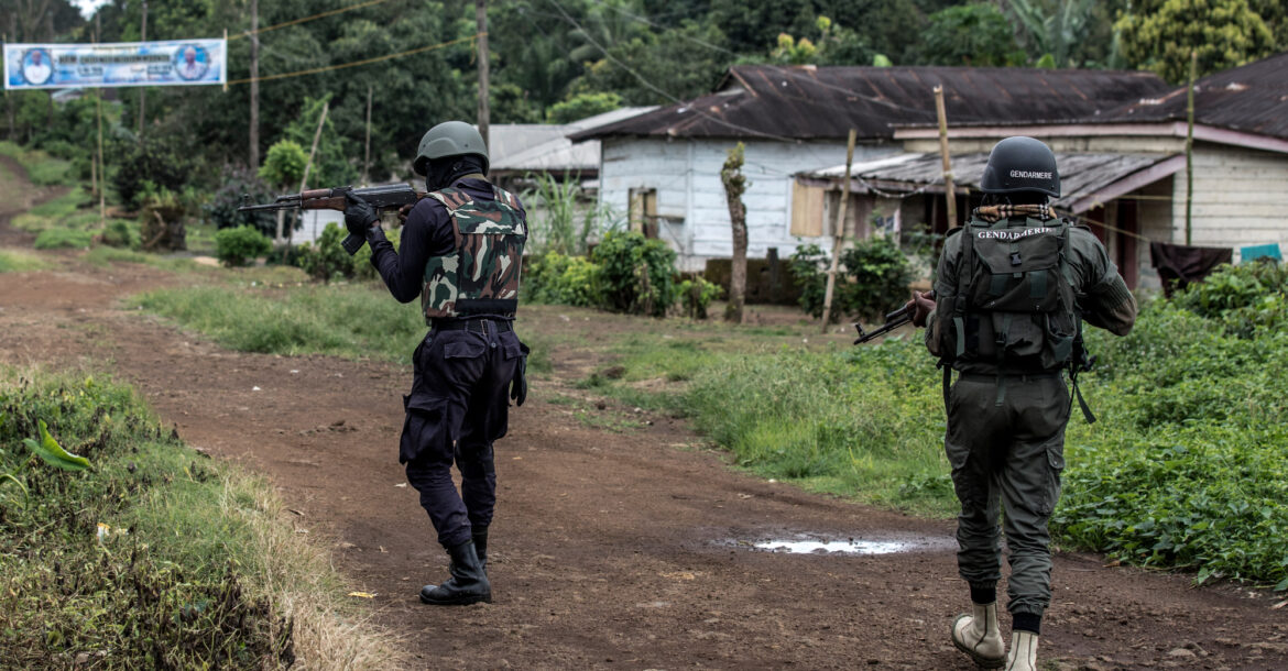 A Cameroonian policeman and a gendarme securing the perimeter of a polling station in Lysoka, near Buea, southwestern Cameroon, on October 7, 2018.