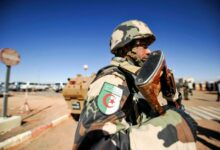 Photo of an Algerian soldier standing guard at the Tiguentourine gas complex, in In Amenas, about 1,600 kilometres southeast of the capital.