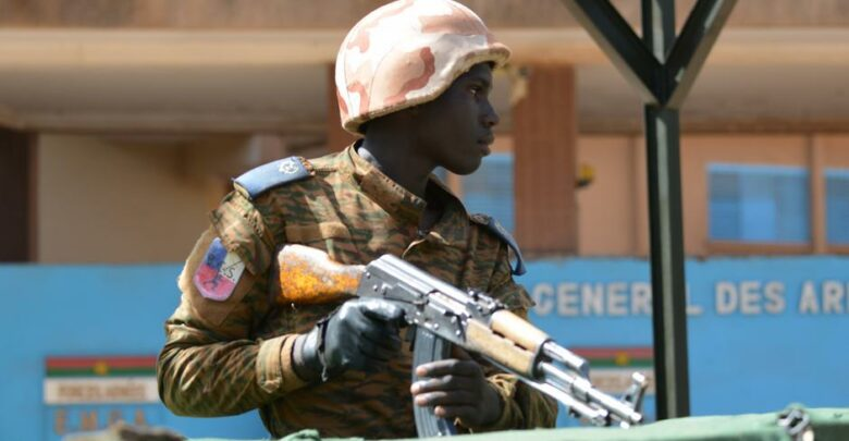 A military personnel stands outside the headquarters of the country's defence forces in Ouagadougou on March 3, 2018 a day after dozens of people were killed in twin attacks on the French embassy and the country's military.