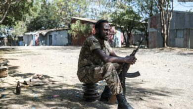 An Ethiopian soldier sits at the 5th Battalion of the Northern Command of the Ethiopian Army in Dansha, Ethiopia, on November 25, 2020