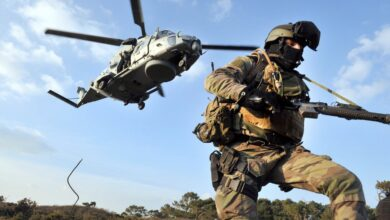 """A soldier of French Jaubert naval commando pictured after getting off a NH90 """"Caiman"""" helicopter during an exercise"""