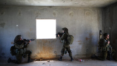 Israeli soldiers of the Golani Brigade take part in an urban warfare drill at a mock village in the Elyakim army base, Northern Israel, May 16, 2017.