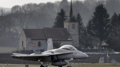 A Swiss Air Force F-18 is seen in front of a church on Feb. 20, 2013, at Payerne airport.