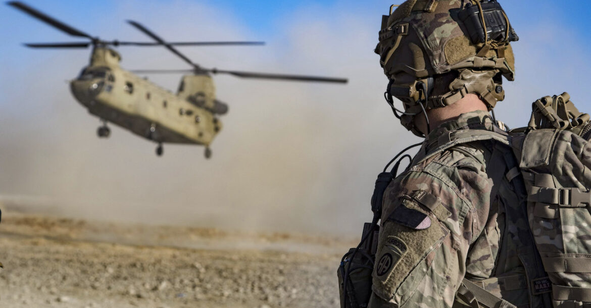 Army Staff Sgt. Jason N. Bobo watches as a CH-47 Chinook prepares to land to provide transport for US and Afghan soldiers after a key leader engagement in southeastern Afghanistan, December 29, 2019