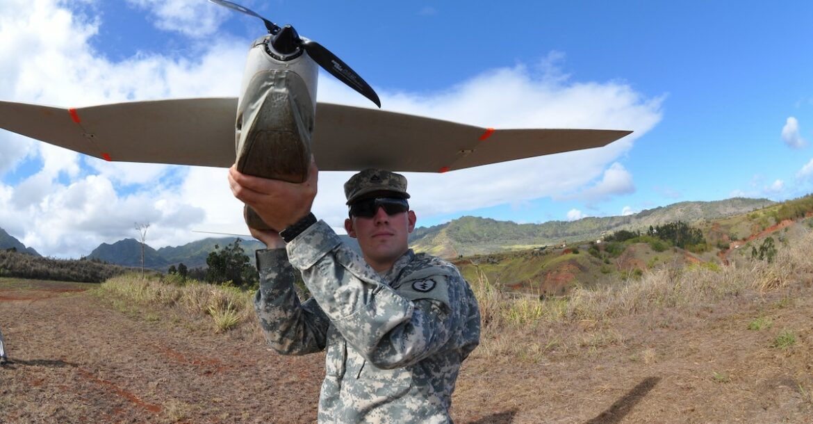 US soldier throwing a PUMA drone.