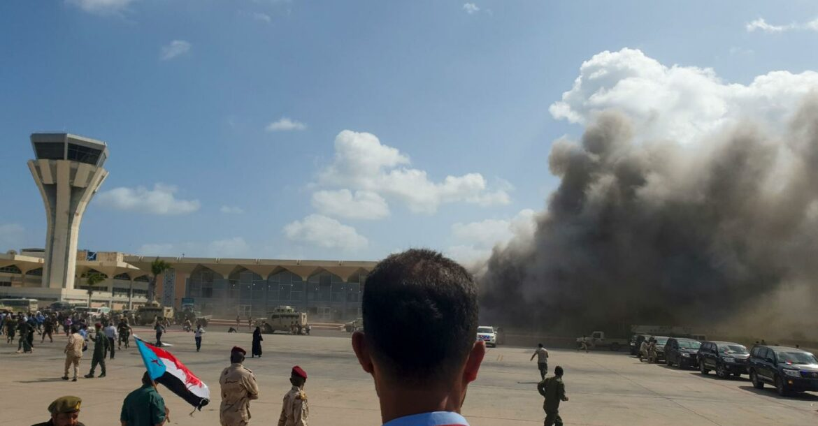 Smoke billows from the airport building in Aden, Yemen.