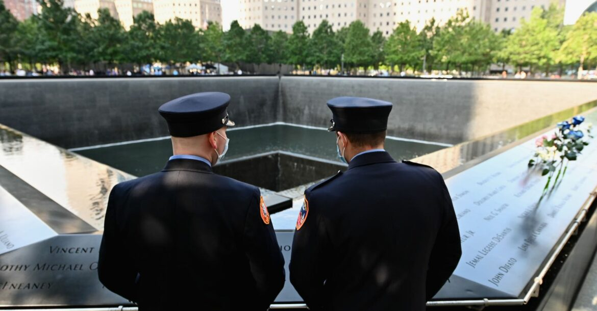 New York Firefighters gather at the 9/11 Memorial & Museum in New York on September 11, 2020, as the US commemorates the 19th anniversary of the 9/11 attacks