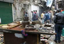 The aftermath of a double bomb attack in a busy market area in Baghdad's central al-Sinaq neighbourhood on December 31, 2016.