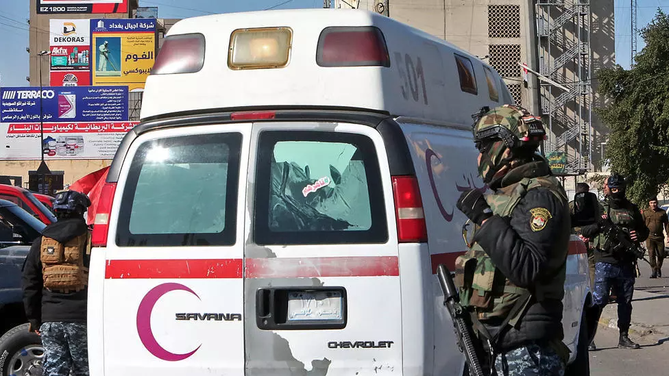 Iraqi security forces at the scene of Thursday's twin suicide bombing.