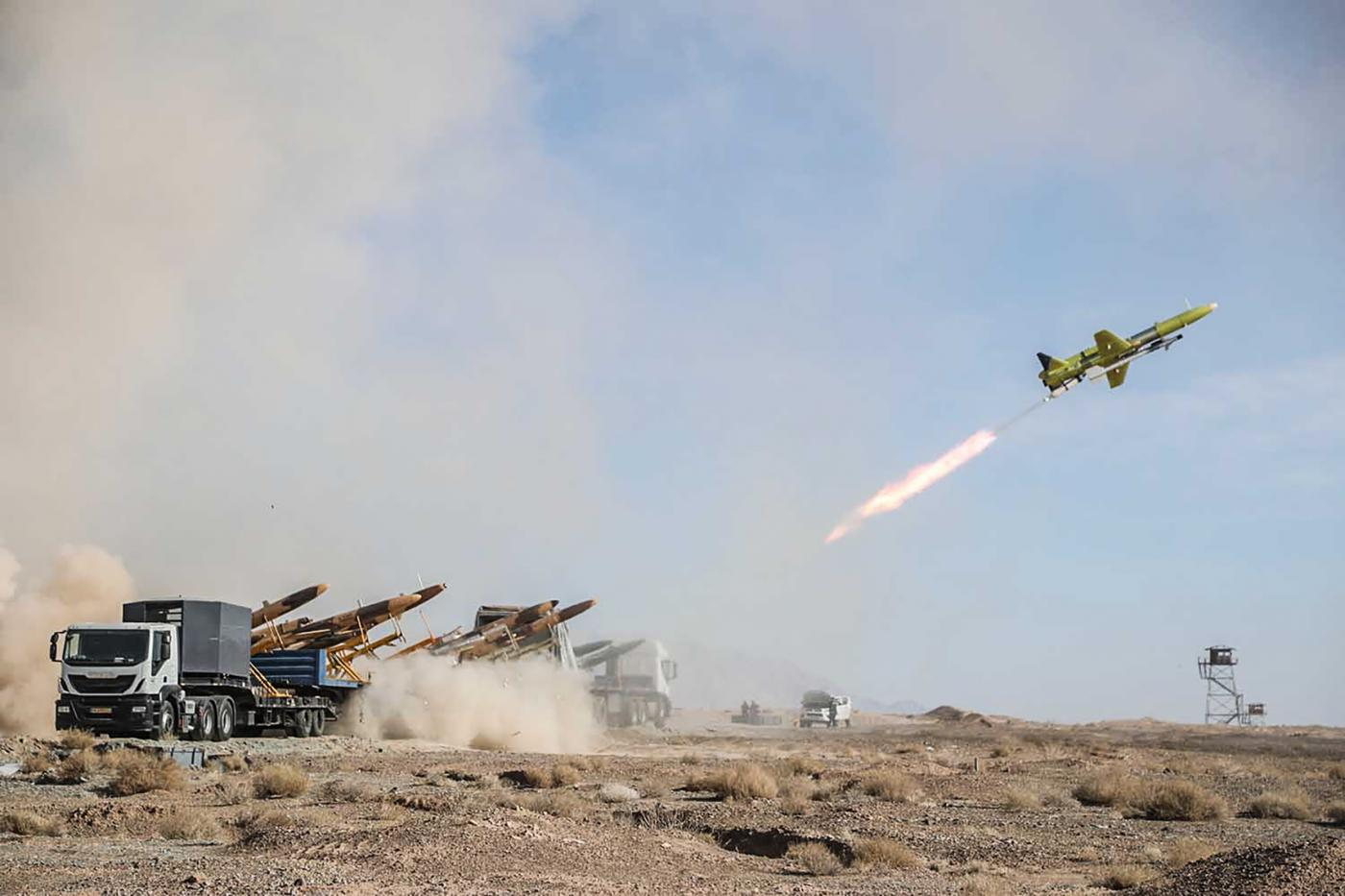 A handout photo from the Iranian Army on 6 January 2021 shows the launching of a drone carrying a missile, during a military drill in central Iran