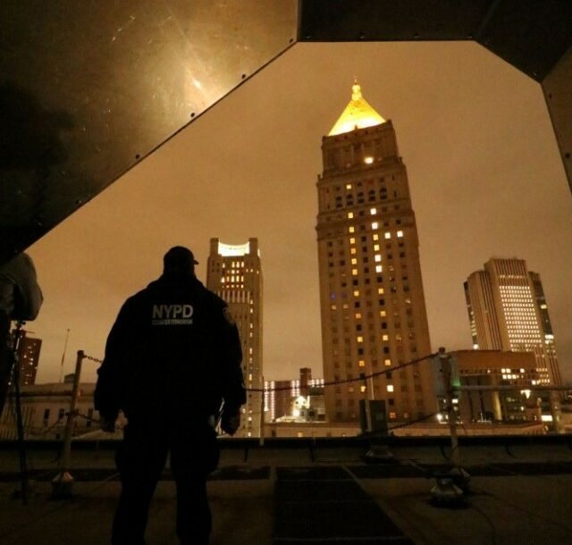 Detective Ralph Gonzalez, Counter Unmanned Aerial Systems Team Lead, New York City Police Department Counterterrorism Division, observes CUAS detection testing from a rooftop as Dense Urban CUAS Materiel Experiment 21-1 was underway in lower Manhattan on October 24